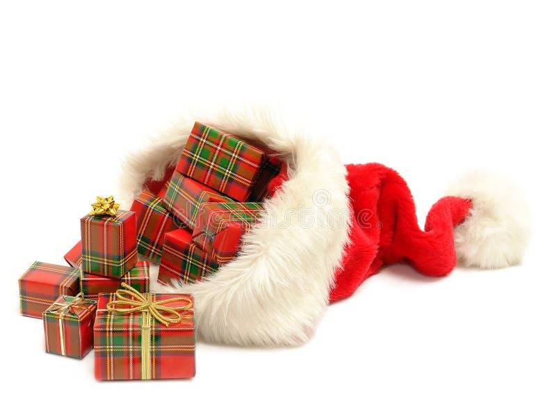 Cadeaux de Noël hors de chapeau du père noël photos libres de droits