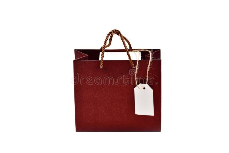 Cadeauzak met doos en etiket geïsoleerd op witte achtergrond royalty-vrije stock afbeeldingen