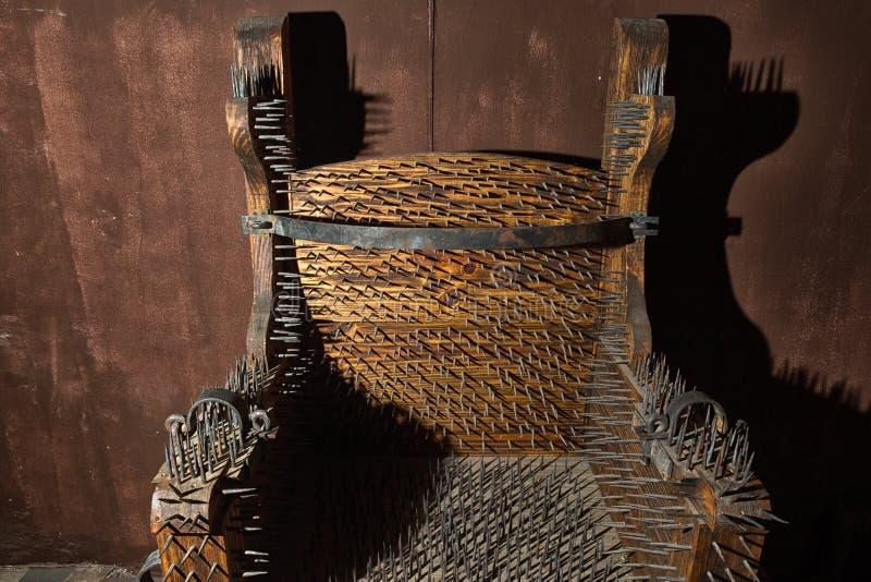 Cadeira da tortura do espanhol foto de stock