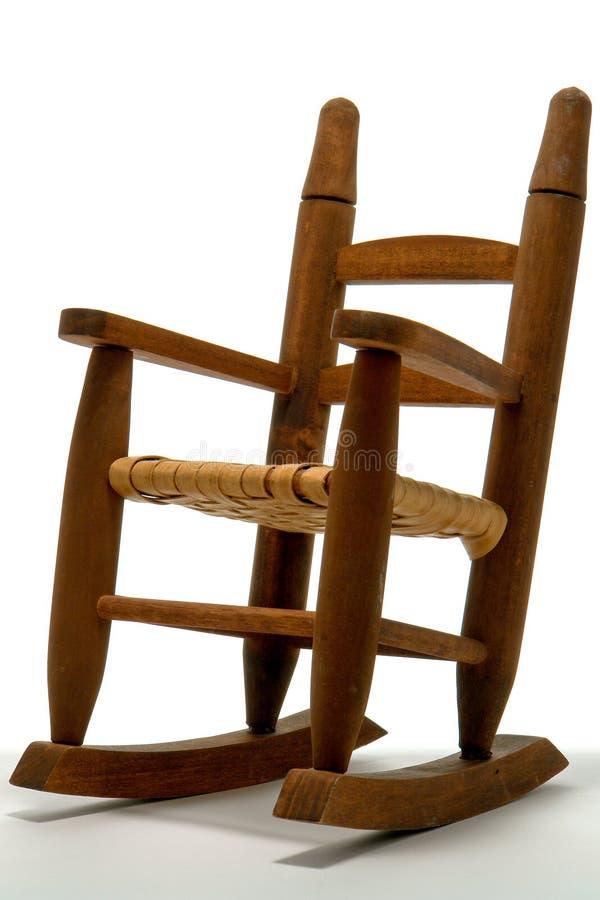 Cadeira de balanço antiga do brinquedo da reprodução imagem de stock