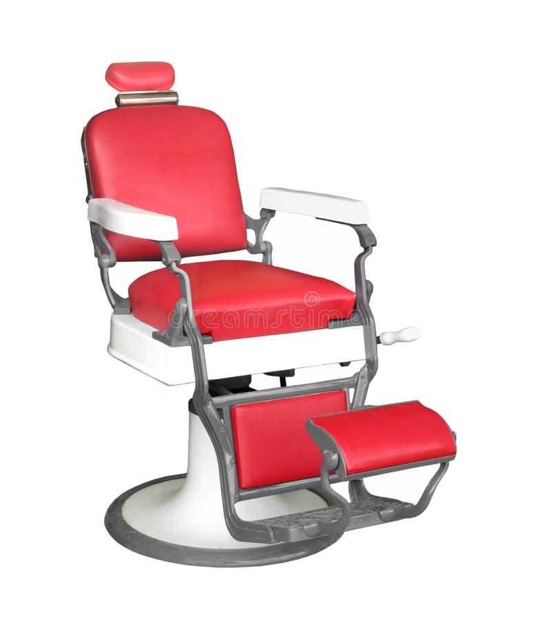 Cadeira de barbeiro do vintage isolada. fotografia de stock