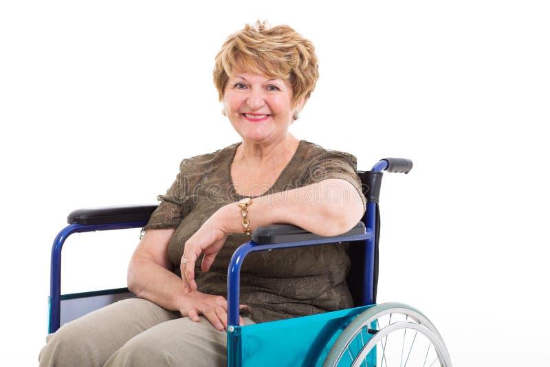 Cadeira de rodas deficiente idosa da mulher fotos de stock