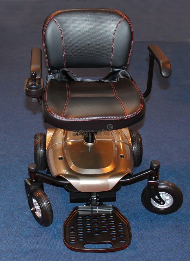 Cadeira de rodas elétrica imagens de stock royalty free