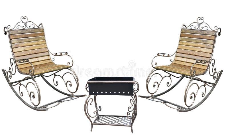 Cadeira do metall e isolado roching forjados bonitos da grade do assado fotografia de stock royalty free