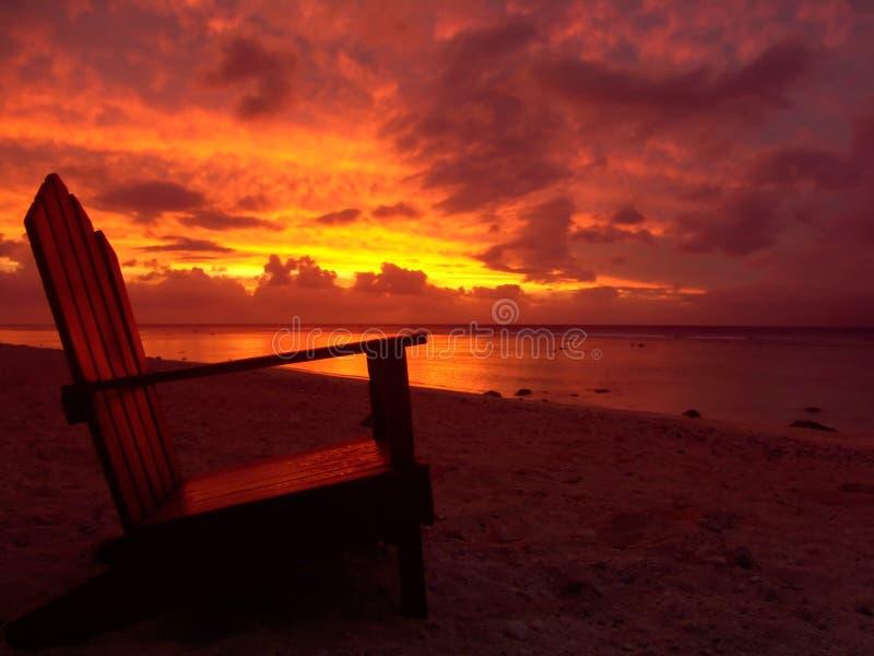 Cadeira e por do sol fotografia de stock royalty free