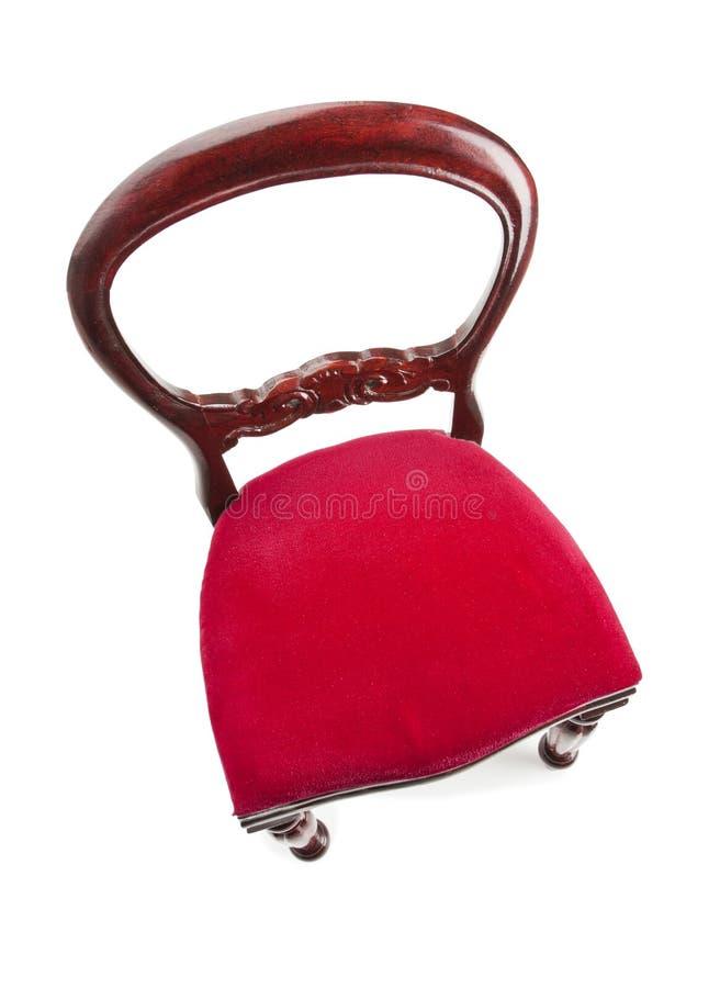 Cadeira estofada vermelha fotografia de stock royalty free