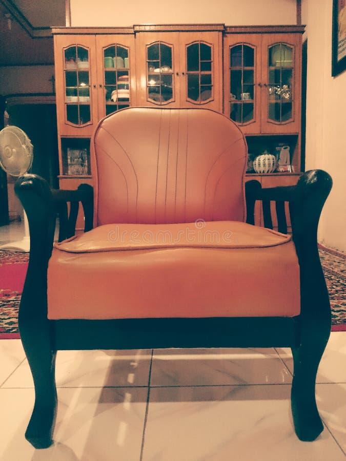 Cadeira home velha foto de stock