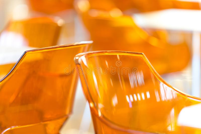Cadeiras amarelas plásticas imagem de stock royalty free