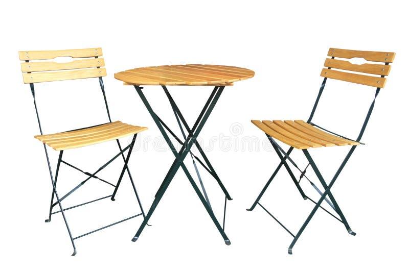 Cadeiras de madeira do Slat e uma tabela imagens de stock royalty free