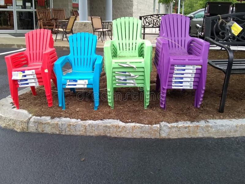 Cadeiras do arco-íris fotografia de stock