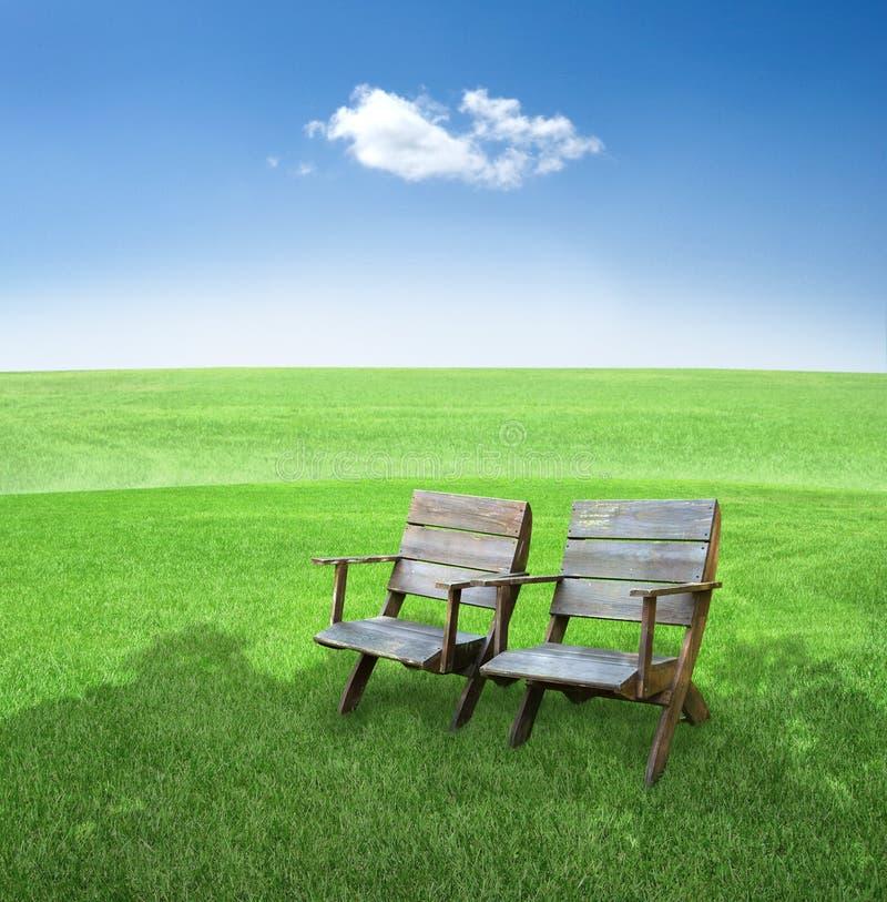 Cadeiras no campo imagens de stock royalty free