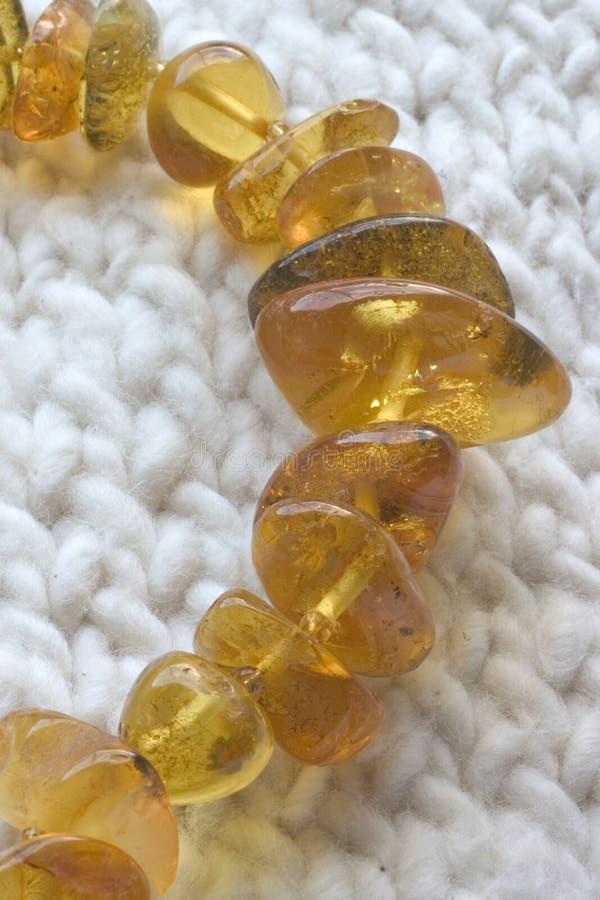 Cadena ambarina de los granos foto de archivo