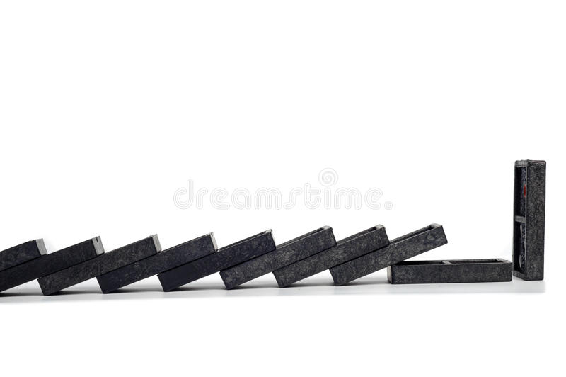 Cadena de la parada del dominó aislada foto de archivo