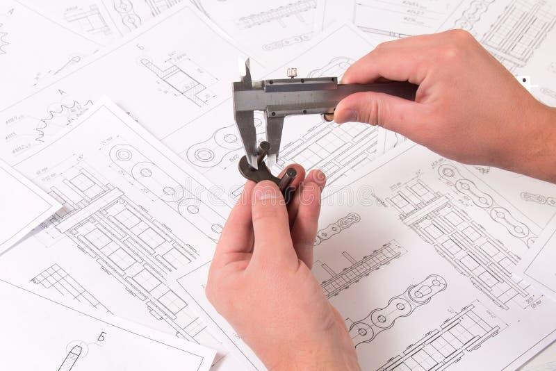 Cadena técnica del dibujo, del calibrador y del rodillo impulsor Ingeniería, tecnología y metalurgia Medida del calibrador del de fotografía de archivo libre de regalías