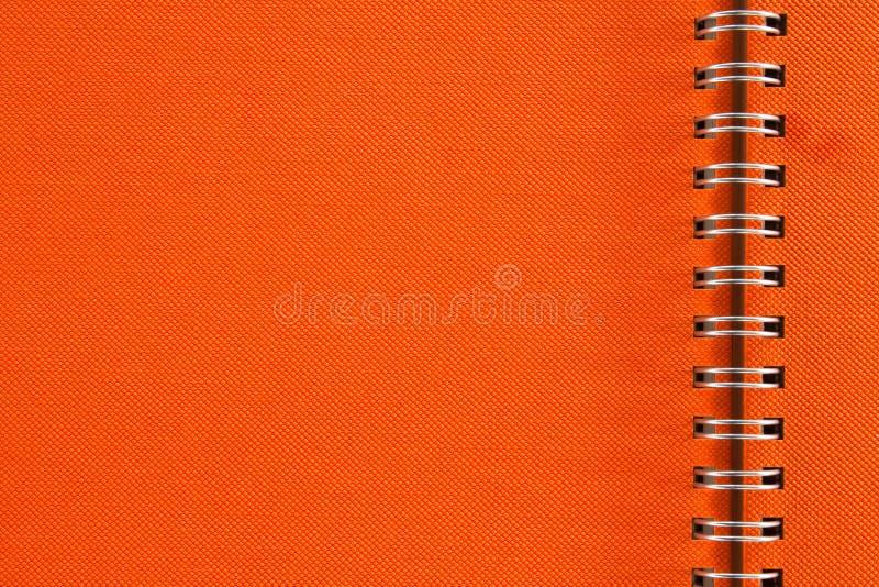 Caderno alaranjado fotografia de stock