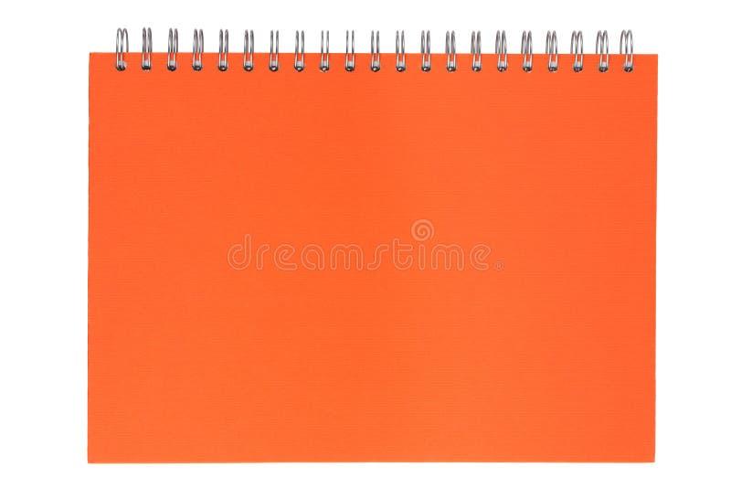 Caderno alaranjado em uma mola imagens de stock royalty free