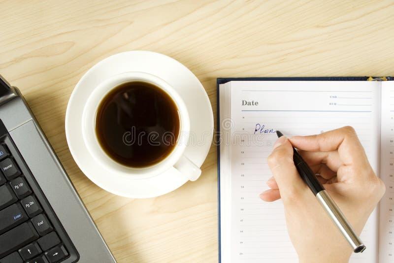 Caderno e café foto de stock royalty free
