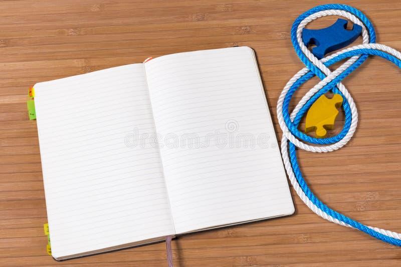 Caderno e enigma imagem de stock