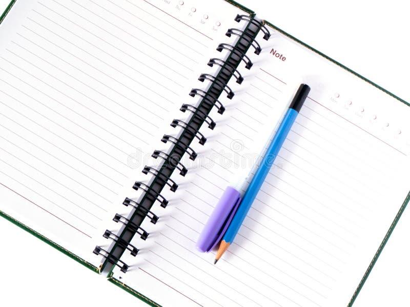 Caderno e lápis de papel, pena imagens de stock royalty free