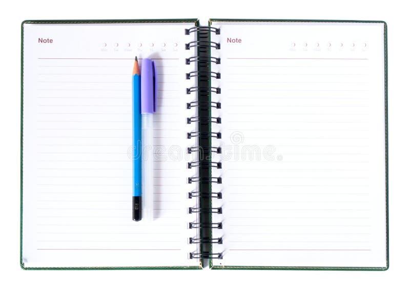 Caderno e lápis de papel, pena imagens de stock
