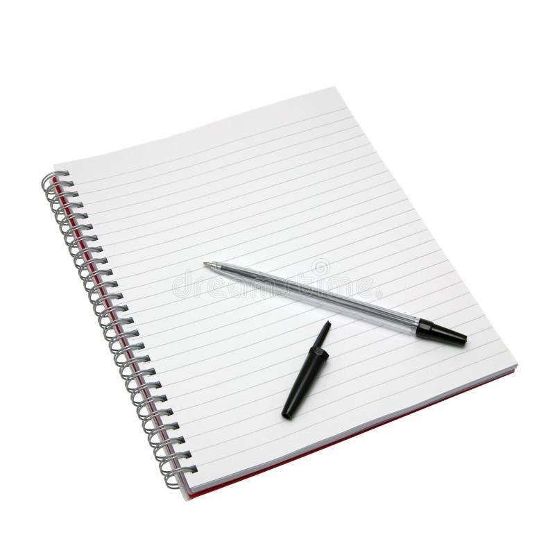 Caderno e pena em branco. imagens de stock