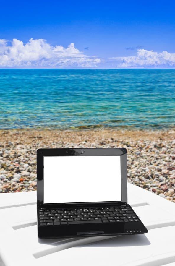 Caderno na praia imagens de stock