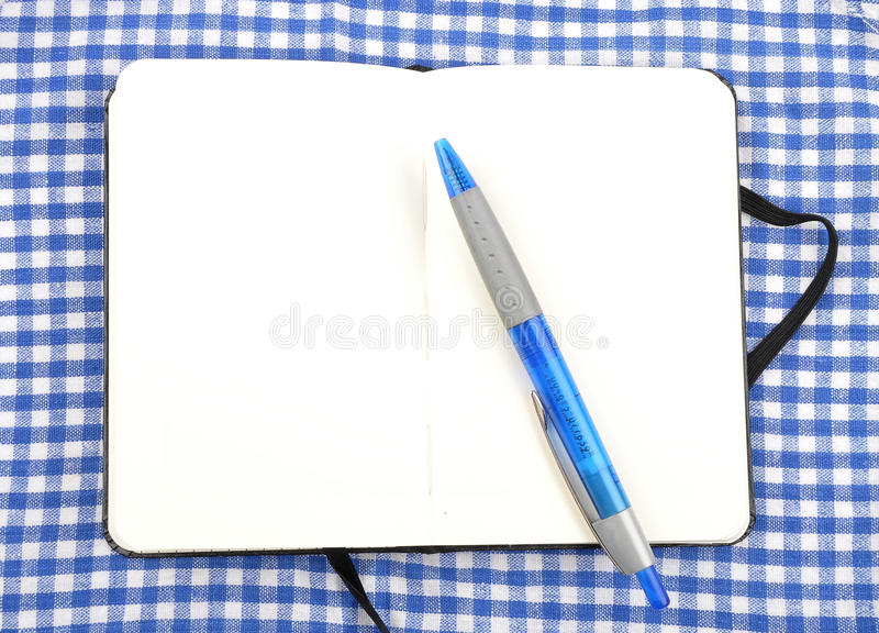 Caderno no pano fotos de stock