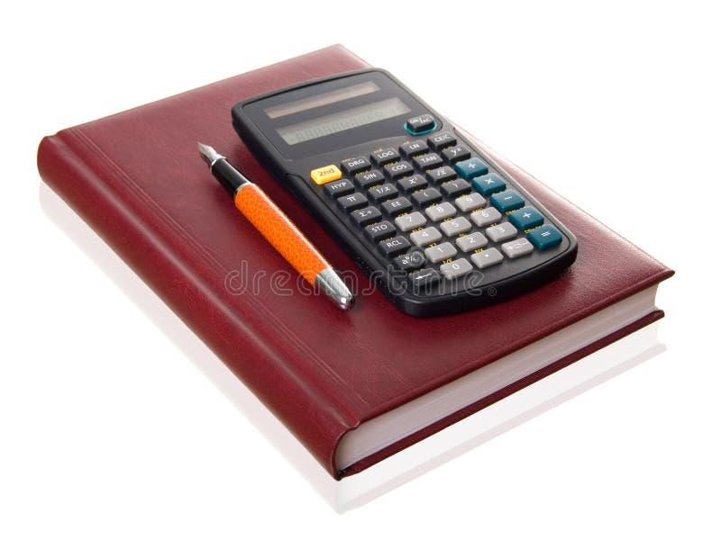 Caderno, pena e calculadora imagem de stock royalty free