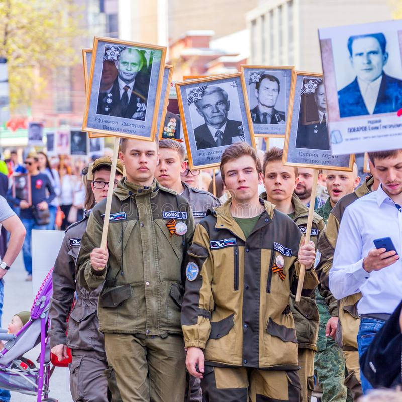 The cadets of the search and history club SVPO `Sokol SGAU` in the action `Immortal Regiment` with portraits of participants. Russia, Samara, May 2018: The stock photo