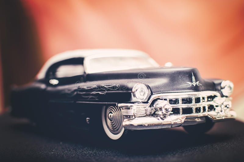 Cadillac 1947 black car. Flat Black 1947 Cadillac with ghost flames, orange background royalty free stock images