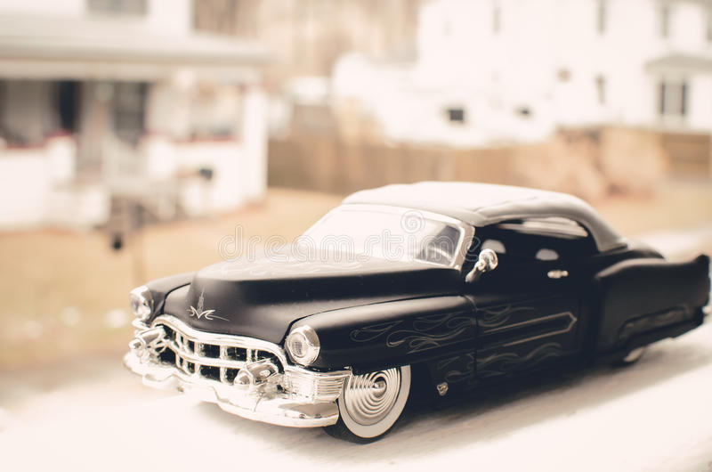 Cadillac 1947 black car on town street. Flat Black 1947 Cadillac with ghost flames on a small town street royalty free stock images
