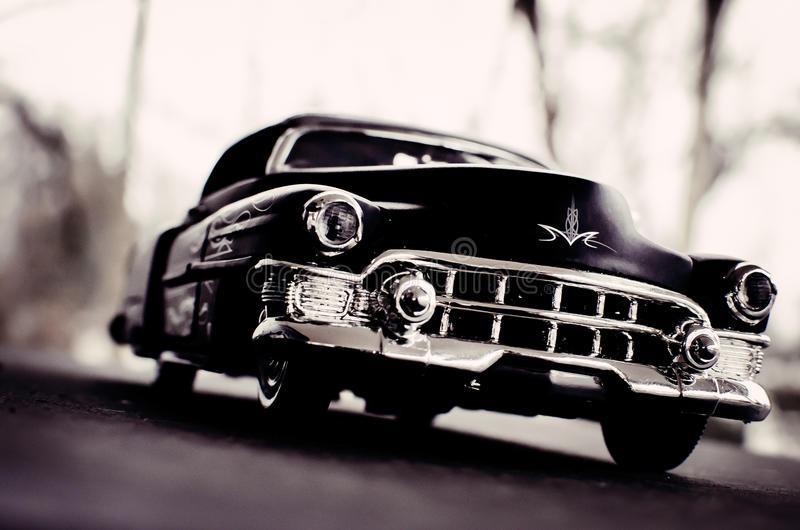 Cadillac 1947 black car. Flat Black 1947 Cadillac with ghost flames, wooded background stock photography