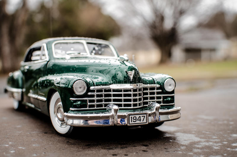 Cadillac 1947 Green. Hunter Green 1947 Cadillac with whitewall tires, wooded background royalty free stock images