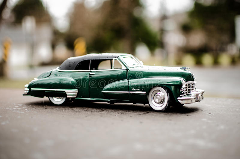 Cadillac 1947 Green. Hunter Green 1947 Cadillac with whitewall tires, wooded background royalty free stock photos