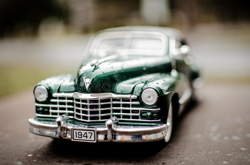 Cadillac 1947 Green. Hunter Green 1947 Cadillac with whitewall tires, wooded background royalty free stock photography