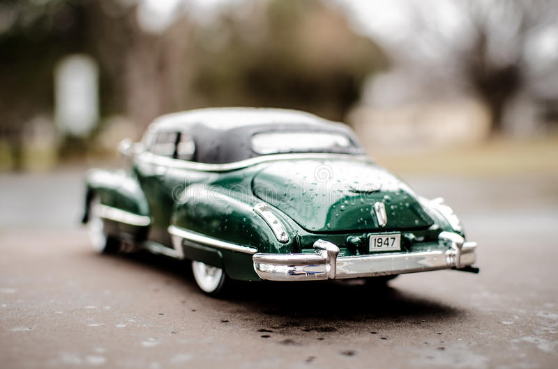 Cadillac 1947 Green. Hunter Green 1947 Cadillac with whitewall tires, wooded background stock photography