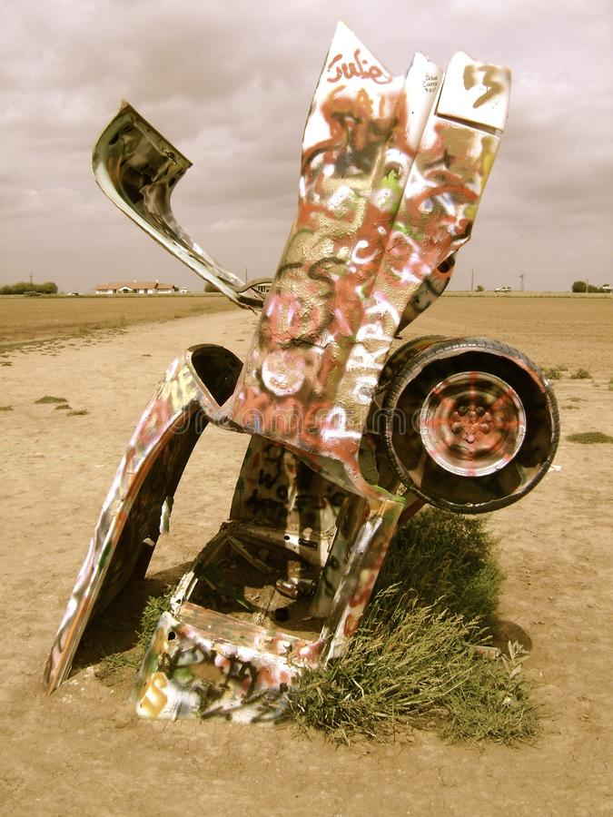 Cadillac Ranch. 1950s era car planted in the ground in a field at the Cadillac Ranch in Amarillo Texas stock photo