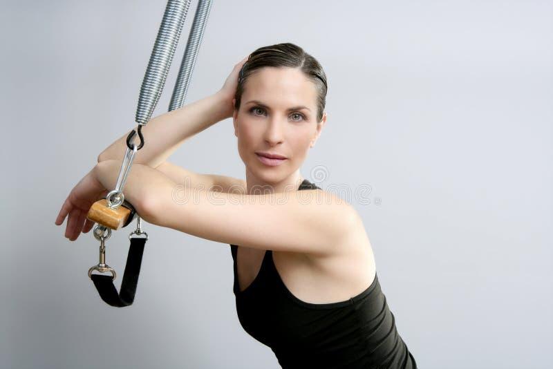 Cadillac trapeze pilates woman fitness sport. Cadillac trapeze pilates woman portrait fitness sport beautiful girl royalty free stock image