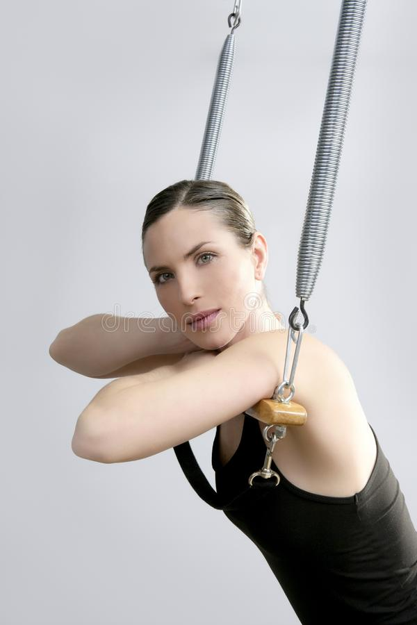 Cadillac trapeze pilates woman portrait. Fitness sport beautiful girl royalty free stock photography