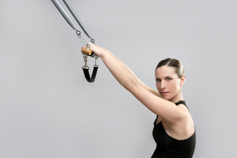 Cadillac trapeze pilates woman portrait. Fitness sport beautiful girl stock images