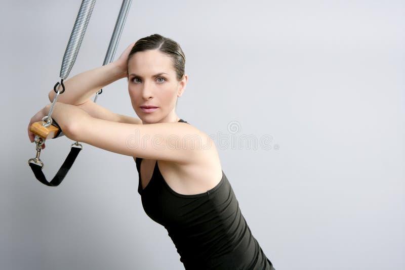 Cadillac trapeze pilates woman portrait. Fitness sport beautiful girl stock photo