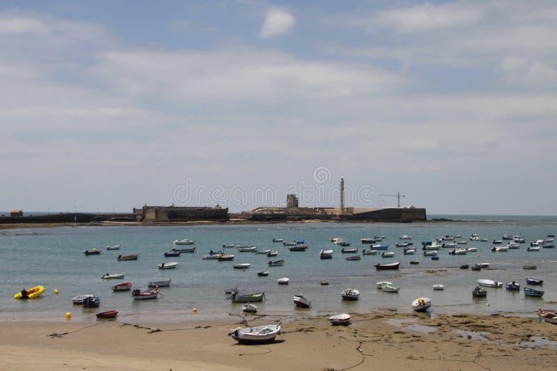 Boats off the Atlantic coast near the fortress of San Sebastian in Cadiz. royalty free stock image