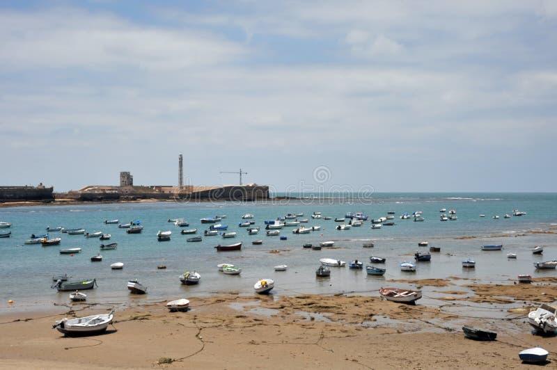 Boats off the Atlantic coast near the fortress of San Sebastian in Cadiz. royalty free stock photography
