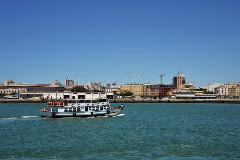 Ships in the harbor of the seaport of Cadiz on the shores of the Cadiz Bay of the Atlantic Ocean. stock image
