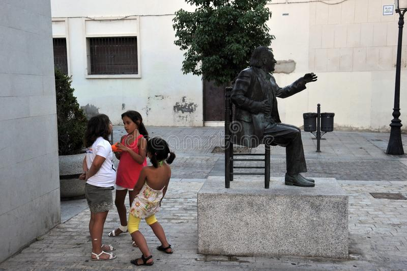 Unknown children at the monument to the famous Spanish singer flamenco Chano Lobato at the center of art `La Merced`in Cadiz. stock image