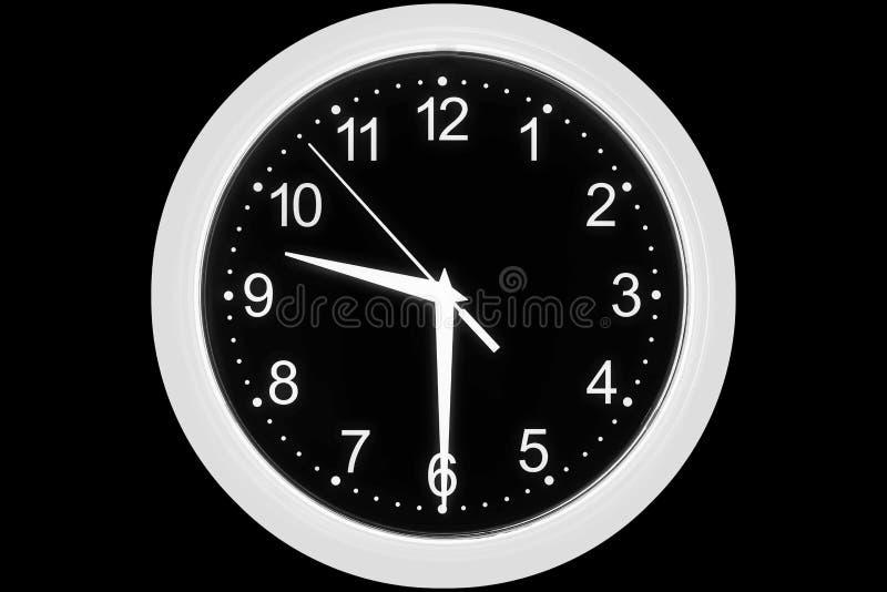 Cadran d'horloge sur un fond noir photographie stock