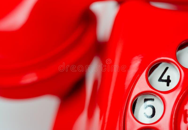 Cadran rotatoire de téléphone rouge photographie stock libre de droits