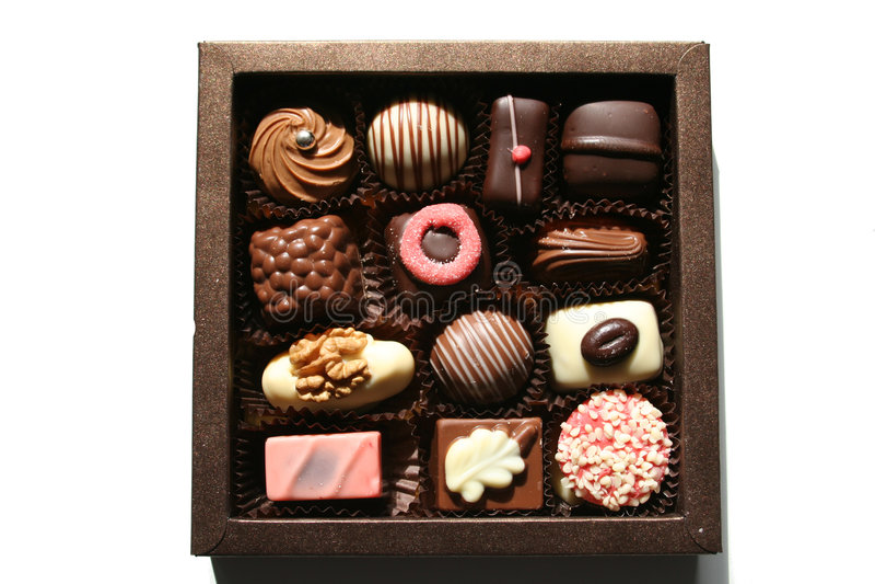 Cadre avec des chocolats magnifiques photos stock