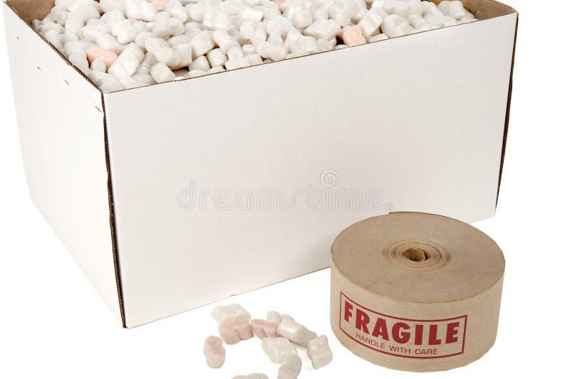Cadre d'arachides d'emballage avec le rouleau de bande fragile image libre de droits
