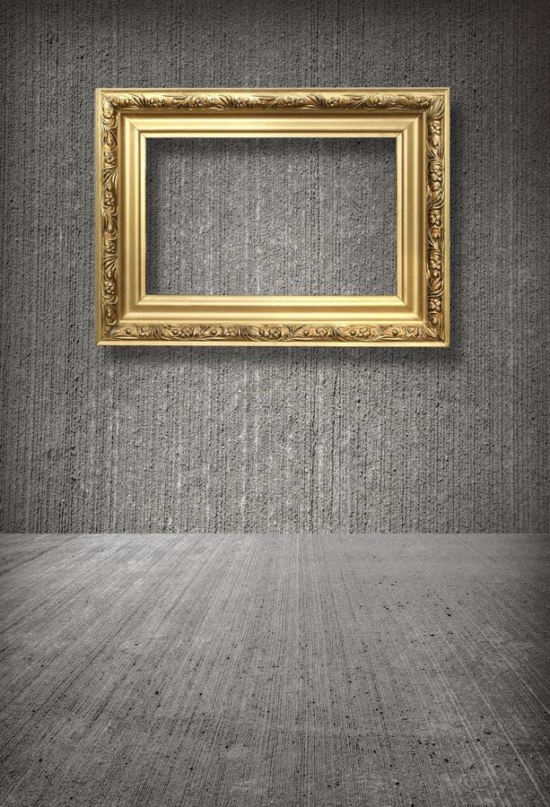 Cadre d'or dans la chambre photo libre de droits